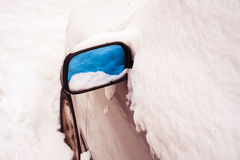 Car covered by snow on snowy winter day Royalty Free Stock Image