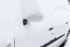 Car covered with snow after a storm Royalty Free Stock Photo