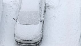 Car under snow winter. Car covered with snow top view stock video footage
