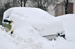 Car covered by snow during winter Royalty Free Stock Photos