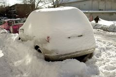 Car covered in snow winter. Snow covered in winter cars snowstorm blizzard heavy snow weather freezing below zero temperature Stock Images