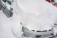 Car covered with snow in the winter Royalty Free Stock Photography
