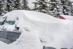 Car covered with snow in the winter Stock Photos