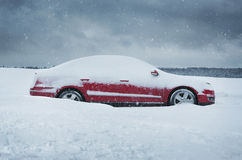 Car covered with the snow. Winter, close up of red car covered with the snow Royalty Free Stock Photo