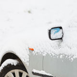 Car covered in snow, winter time Royalty Free Stock Photos
