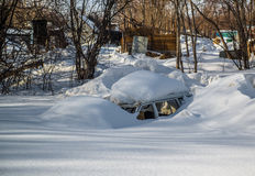 Car covered in snowdrift Stock Photos