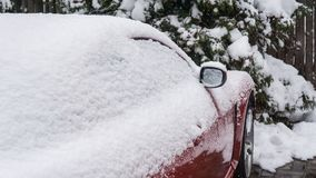 The car, covered with thick layer of snow. Negative consequence of heavy snowfalls. parked cars stock image