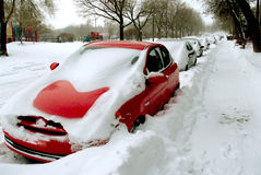 Winter. Parked cars covered by snow after a blizzard storm Stock Photos