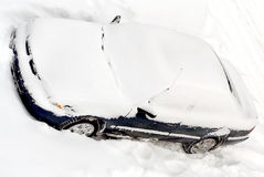 Car covered in winter snow  Stock Photo