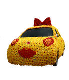 Car cowered with flowers isolated on white. Funny car wrapped with gerberas. No copyrights or trademarks on the picture Royalty Free Stock Photo