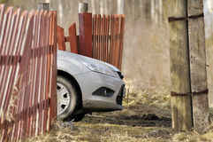 Car cowl behind an old fence in rural areas. Car cowl behind old fence in rural areas Stock Photography