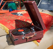 Car cowl GAZ-M-20 Pobeda with an old record player and a lying flag on show of collection Retrofest cars Royalty Free Stock Images