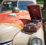 Car cowl GAZ-M-20 Pobeda with an old record player and a lying flag on show of collection Retrofest cars Stock Image