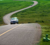 Car on cranked road in fall season Stock Photography