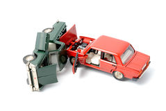 Car crash. Toy cars in accident on a white background Royalty Free Stock Photography