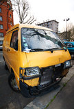 Abandoned car accident. View of a yellow car crash on the street Stock Images