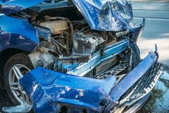 Car crash accident on city street, damaged automobile, broken vehicle. Dangerous Stock Images