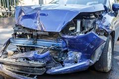 Car crash accident on city street, damaged automobile, broken vehicle. Dangerous driving Royalty Free Stock Image
