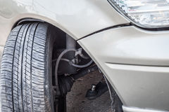 Car crash accident, impact to front wheel axle and bumper is bro Royalty Free Stock Photo