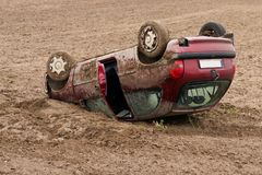 Car crash. Accident of red car roofing Royalty Free Stock Photo