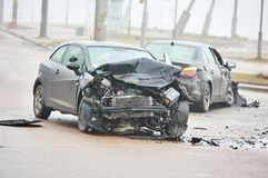 Car crash accident on street, damaged automobiles after collision in city. Car crash accident or collision in city on street, two damaged automobiles royalty free stock images