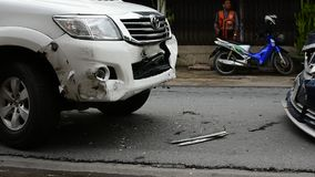 Car crash from car accident on the road. Bangkok, Thailand - June 17, 2016 : Car crash from car accident on the road in a city between saloon versus pickup wait stock video