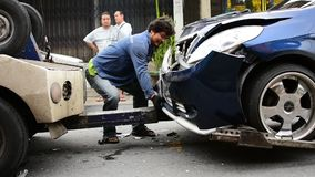 Car crash from car accident on the road. Bangkok, Thailand - June 17, 2016 : Car crash from car accident on the road in a city between saloon versus pickup wait stock footage