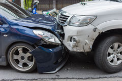 Car crash from car accident on the road. In a city between saloon versus pickup wait insurance royalty free stock images