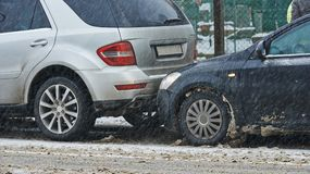 Car crash collision in winter. Car crash collision accident on an city road in winter stock photography