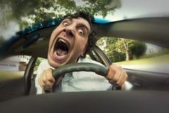 Car Crash Face. Silly man gets into car crash and makes ridiculous face Royalty Free Stock Photo