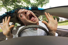 Car Crash Face. Silly man gets into car crash and makes ridiculous face Stock Photography