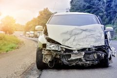 Car crash. Front of car, car crash get damaged from accdent on street, rain makes slippery roads and road emegencies Royalty Free Stock Images