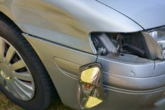 Car crash, the vehicle with a damaged fender, bumper and blinker Royalty Free Stock Photos