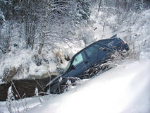 Car crash winter. Flew off the road into the Creek. Winter road in Russia royalty free stock image