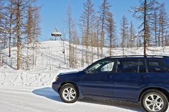 Car crosses the line of northern polar circle along  winter road near the sign `Polar Circle`. In Yakutia Stock Images