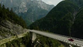 Car crossing the arch bridge stock video