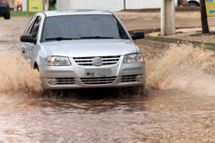 Car crossing flooded street after rains Royalty Free Stock Photo