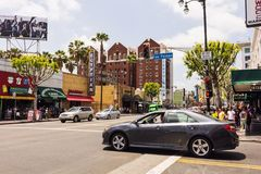 Car crossing Hollywood boulevard Stock Photos