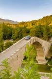 Car crossing hunchback bridge Royalty Free Stock Photo