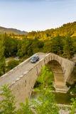 Car crossing hunchback bridge Royalty Free Stock Photography