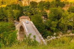 Car crossing hunchback bridge Stock Image