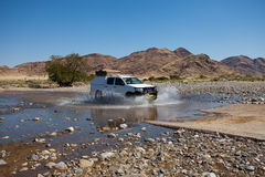 Car crossing river Stock Photos