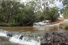 Car crossing a river, Australia Stock Photos