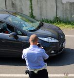Car crush accident. July 20, 2013, Italy: Car crush accident and the agent take proof with mobile phone for the insurance claim Stock Images