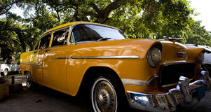 Car in cuba. Old style yellow car on the streets of cuba Stock Image