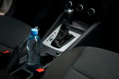 In a car in a cup holder there is a bottle of water. In a car in a cup holder there is a bottle of  water Royalty Free Stock Photos