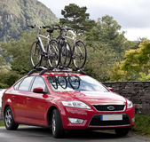 Car cycle rack. Bikes loaded for transport on a cycle rack on top of a car Stock Photography