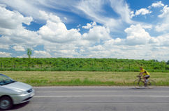 Car and cyclist Royalty Free Stock Images