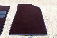 Car 3D handmade floor mats of brown color from wool for front and rear passengers of a vehicle in an interior design workshop with. Tools royalty free stock photography