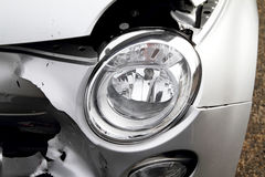 Car Damage. To the front of a white car Stock Images